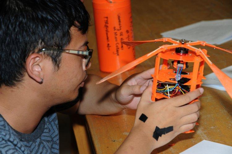Student checking CanSAT pre flight..jpeg