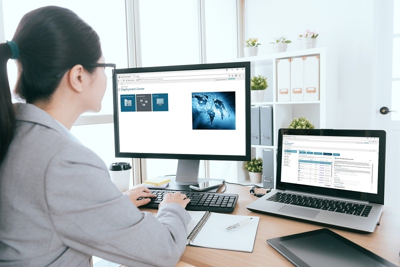 Our PLM Guide to Deployment Center: this image shows a woman working with deployment center on a computer screen