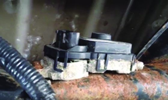 Zinc backed ECU causing galvanic corrosion while in contact with steel support in a truck