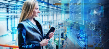 Employee checking IoT data on the shop floor