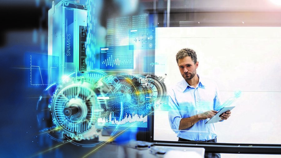 Employee examining motor in factory for optimizations