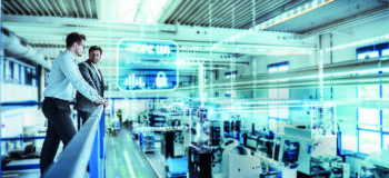 Employees examine the shop floor for optimizations with IoT