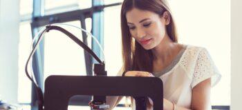 Woman watching polymer 3D printer