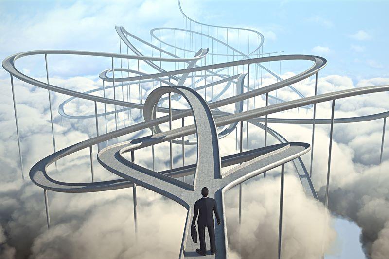 businessman walking on a rollercoaster