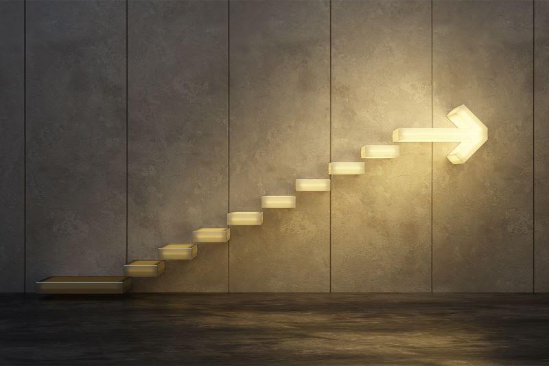 illuminated stairs with arrow