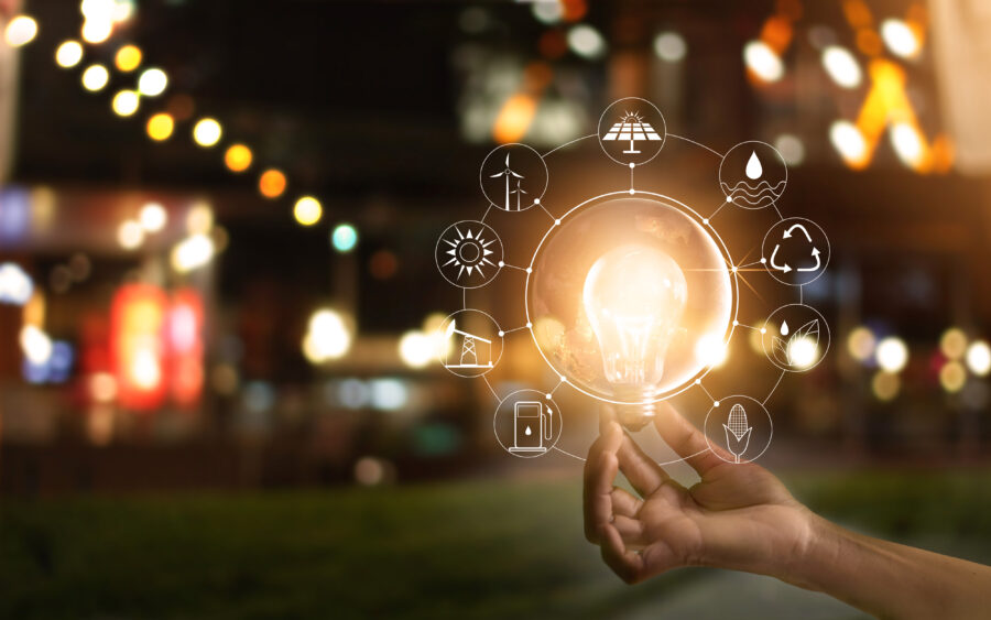 hand holding illuminated lightbulb