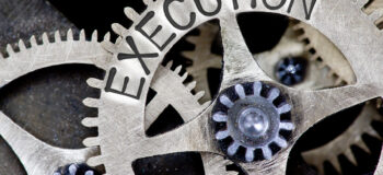 gears connected with execution written on cog