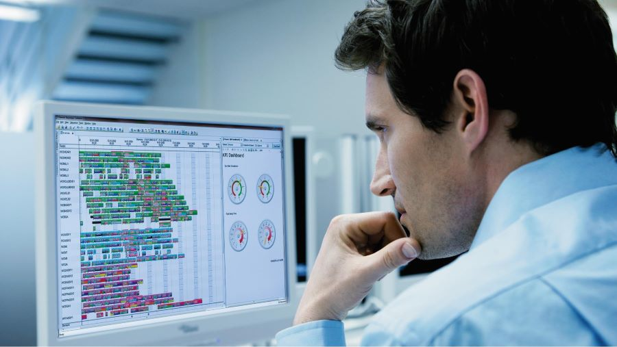 Engineer looking at scheduling software on computer