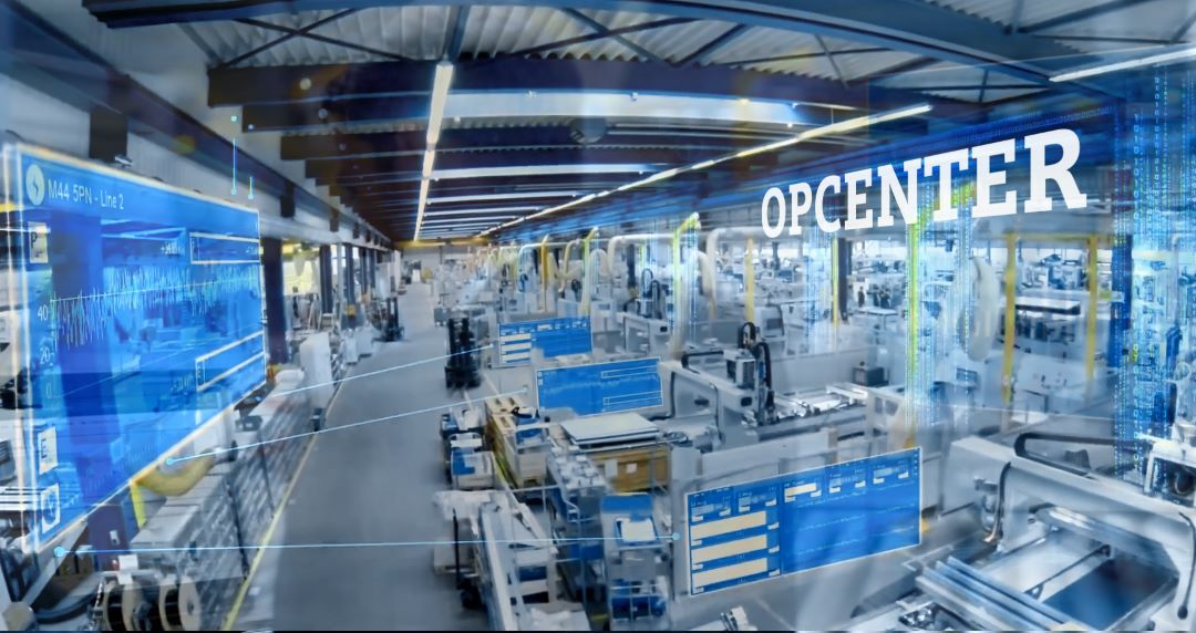 Picture of a manufacturing floor showing the connectivity between manufacturing systems, the cloud, and IIOT