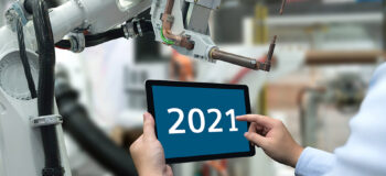 manufacturing engineer holding tablet with 2021 text, representing manufacturing outlook for 2021