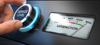 Hand turning a service level knob up to the maximum with a dial where it is written the word satisfaction. Concept image for illustration of how Advanced Planning and Scheduling APS can impact on-time delivery and customer satisfaction.