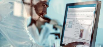 R&D lab technician using smart software applications to digitalize R&D test and verification data