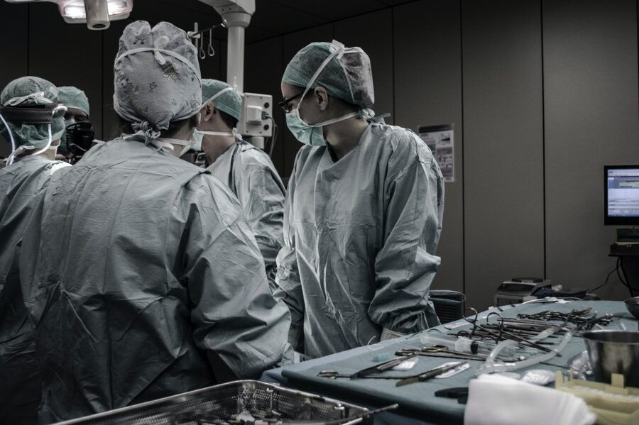 Doctors in an operating room using high quality medical device equipment