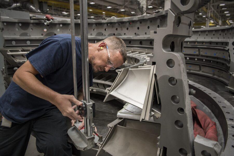 Manufacturing image shows man servicing an asset.