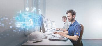 Service technician remotely monitors industrial IoT (IIoT) machines in use