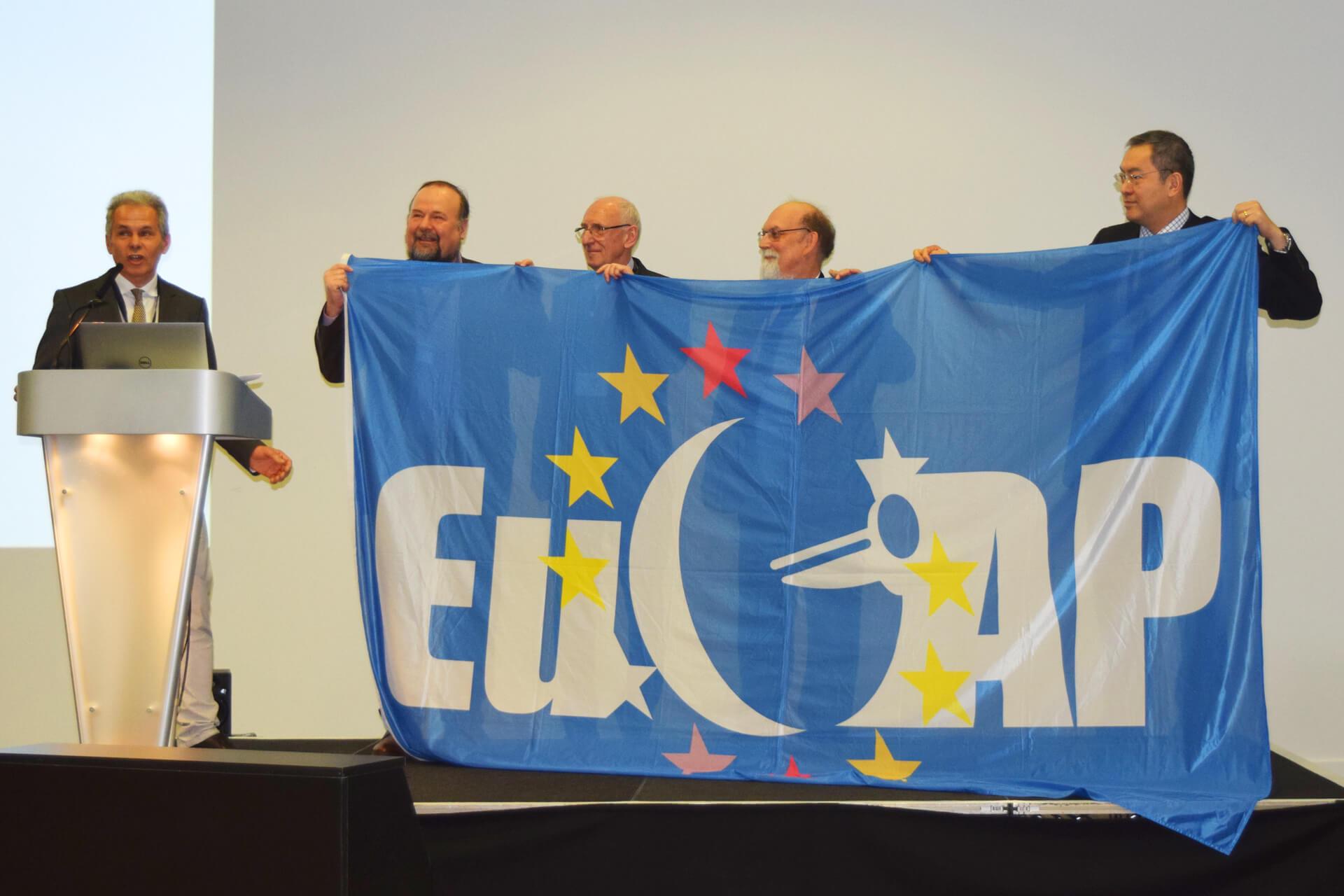 EuCAP_flag_to_Krakow2019_1920px.jpg