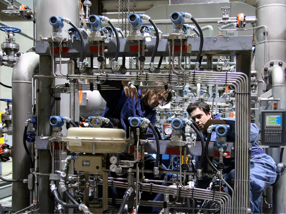 Engineers commissioning a machine
