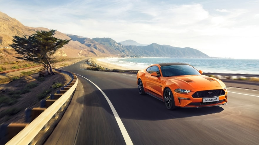 The displayed orange Ford Mustang sports car features a 2.3-litre EcoBoost downsized engine.