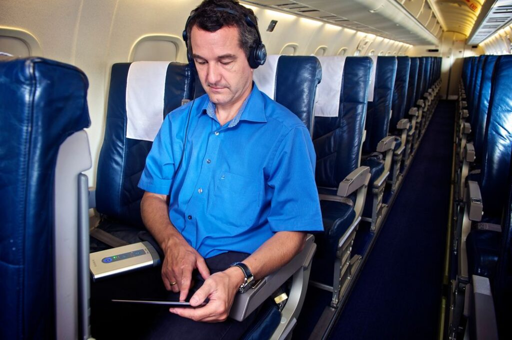 An engineer measure noise inside an aircraft cabin for improved cabin comfort