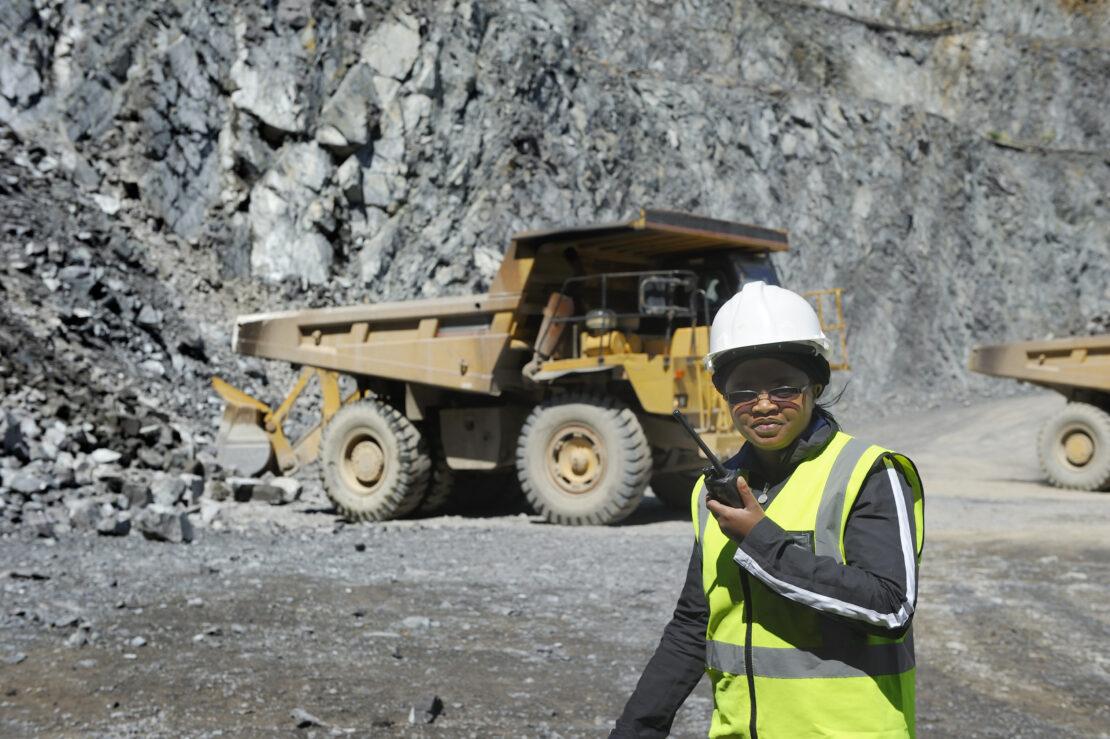Female mine official supervises work