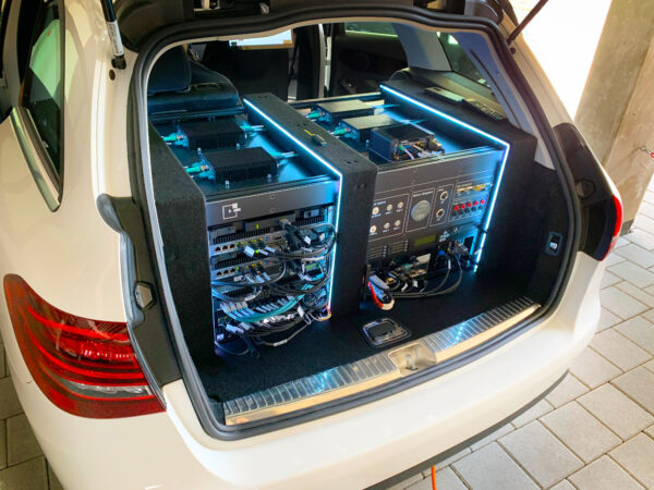 The Simcenter SCAPTOS ADAS sensor data collection system in a vehicle's trunk.