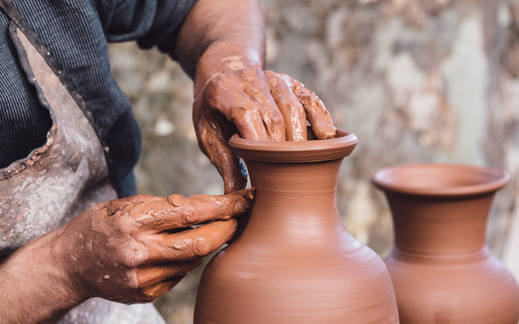 Close-up view of a ceramist making a pottery vase