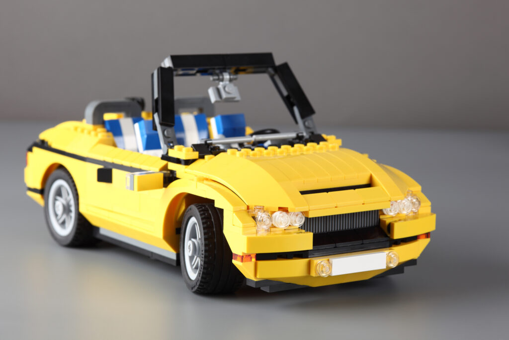A yellow car made of Lego blocks