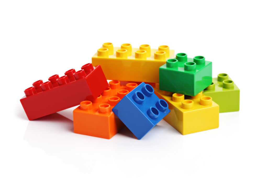 A stack of loose, colored Lego blocks