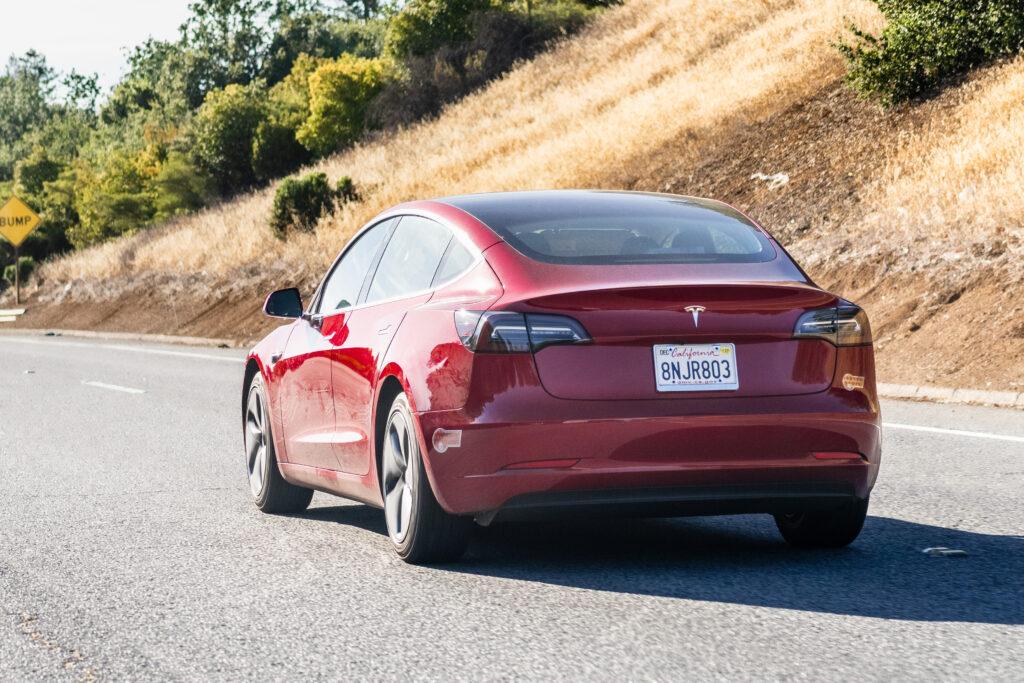 Tesla Model 3 driving on the freeway