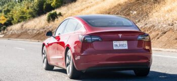 Tesla Model 3 driving on the freeway