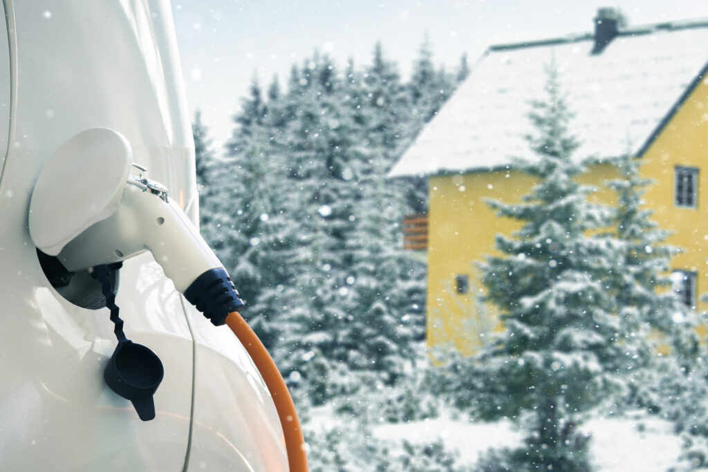 Electric car charging batteries in a snowy landscape