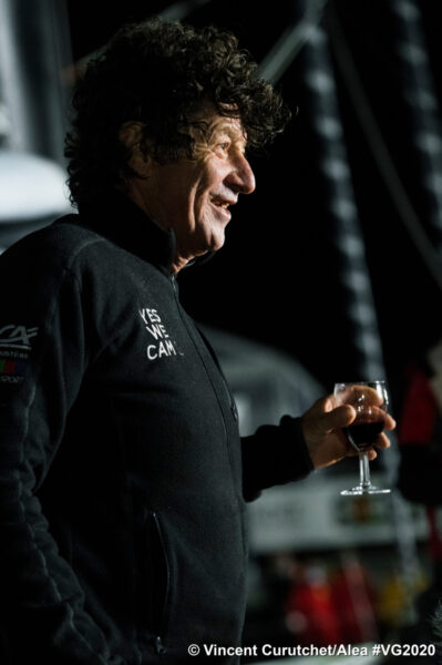 Iconic sailor Jean Le Cam enjoys a glass of red wine to celebrate his arrival in Les Sables d'Olonne, France. He finished 4th in the Vendée Globe race around the world.