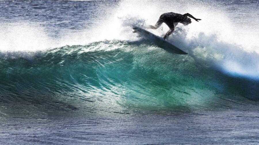Surfer at Margaret River, Australia