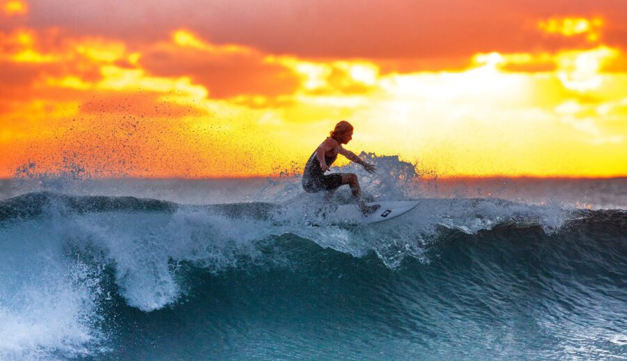person on surfboard surfing on a wave