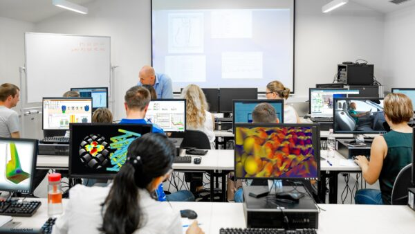 A class of students learning how to use 3D CAE simulation with Simcenter