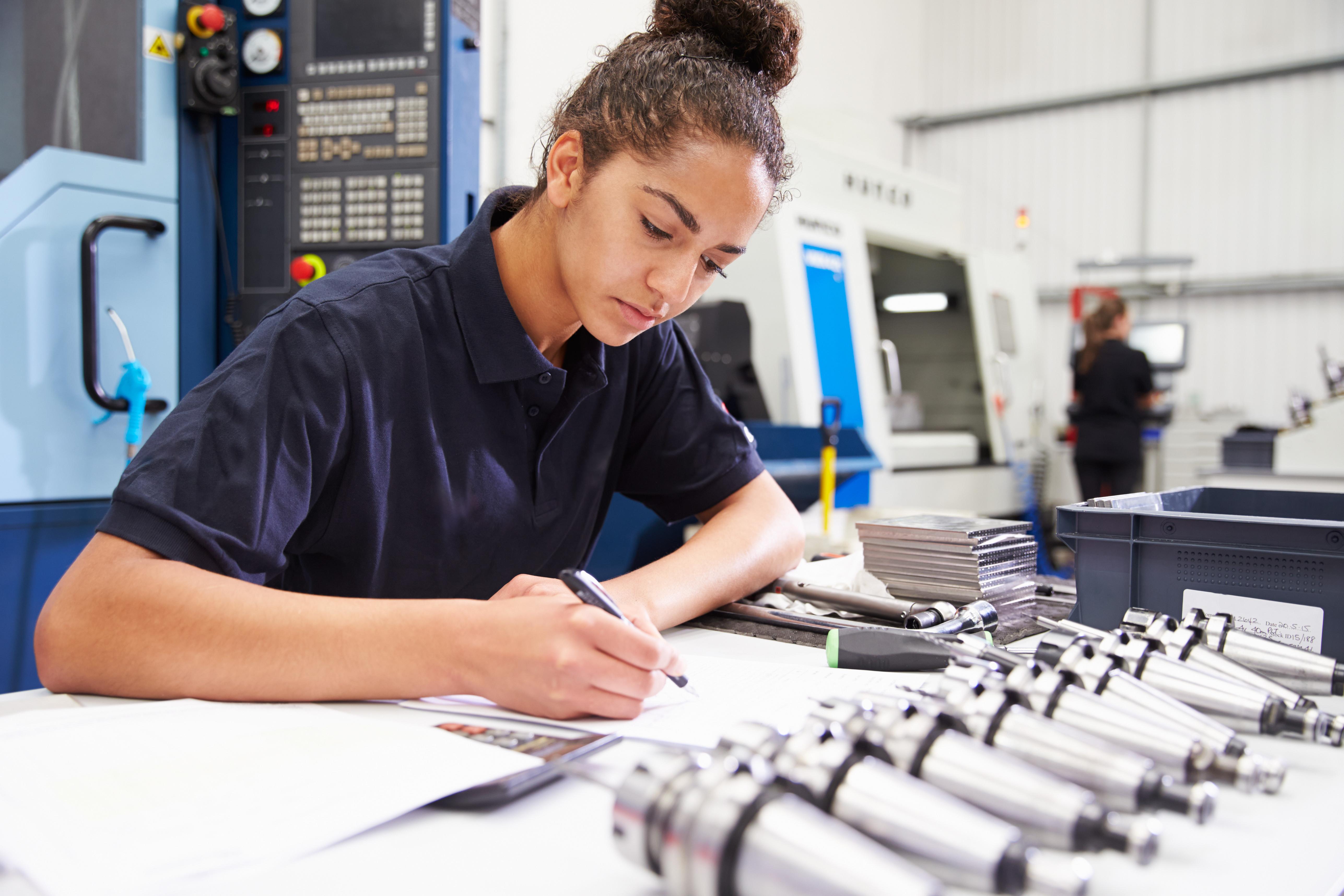 Female student making a note.jpg