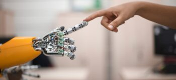 Human and robot hands touching